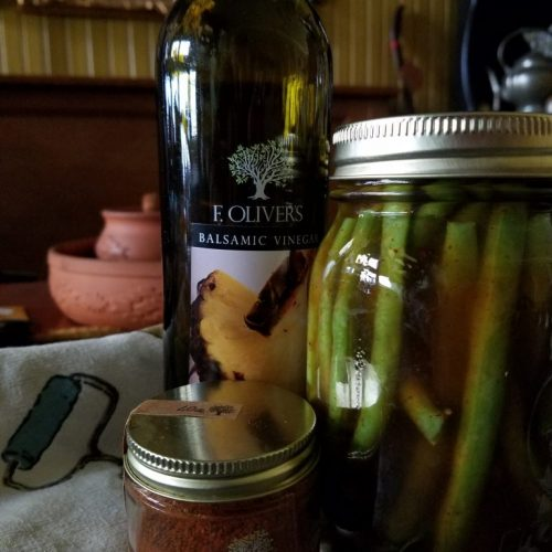 F. Oliver's Sunny Pineapple Balsamic, baharat spice blend, and a jar of pickled green beans