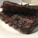 rack of ribs with a blueberry balsamic glaze