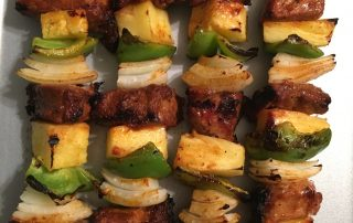 skewers of chicken, fruit, and vegetables with a smoky chipotle olive oil and raspberry treat balsamic glaze
