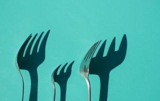 stylized forks on blue background