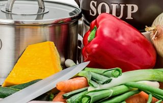 variety of fresh vegetables and a large soup pot