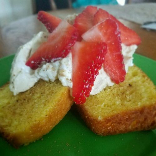 slices of lemon caked topped with mascarpone and strawberries