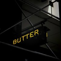 Butter spelled in yellow neon light