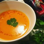 Bowl of tomato soup and tunisian harissa extra virgin olive oil